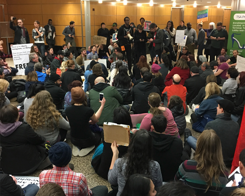 Photo of protestors at Sea-Tac Airport