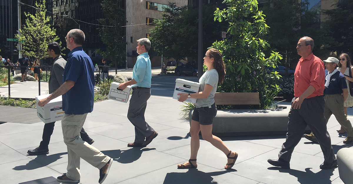 Photo of coalition partners delivering over 150,000 signatures to Amazon asking them not to sell face surveillance systems to the government