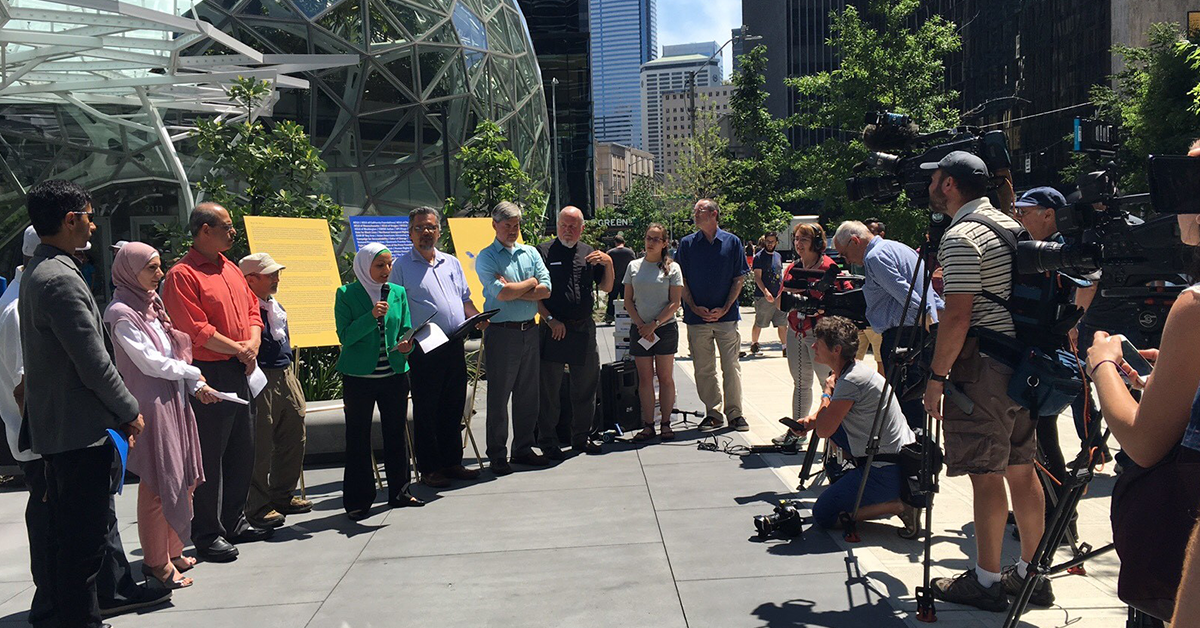 Photo of a press event outside Amazon's headquarters protesting the marketing of face surveillance systems to the government