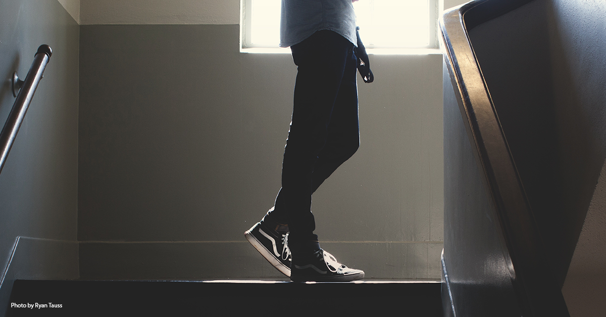 Photo of a student standing on a staircase