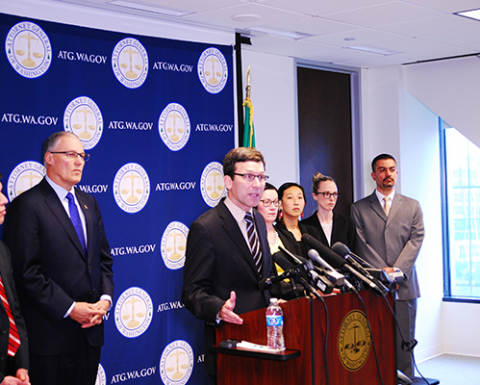 Photo of Washington Attorney General Bob Ferguson speaking at a press conference