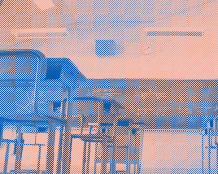 image of generic classroom with seats and green chalkboard