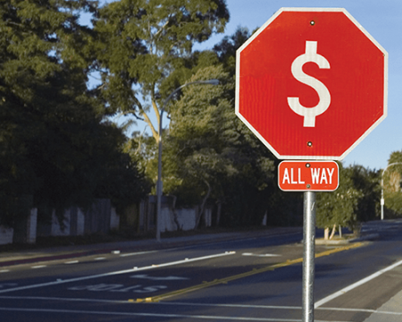 Photo of a stop sign with a dollar sign instead of the word stop