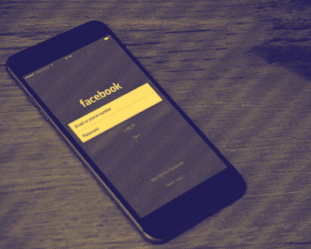 Image of a phone with a facebook login screen