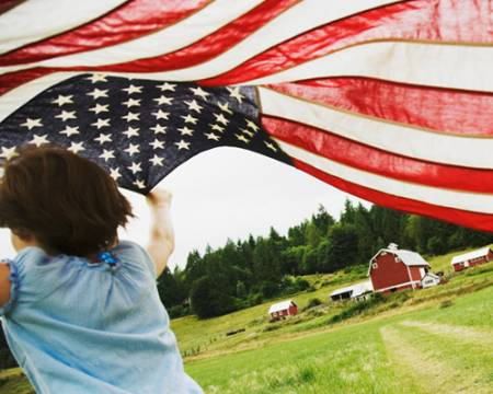 Photo of a girl holding an American flag