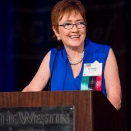 Photo of Executive Director Kathleen Taylor at the podium