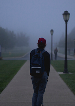 Photo of a student walking linking to our guide to defending youth in truancy proceedings