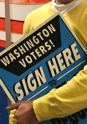 Photo of a signature gathering sign